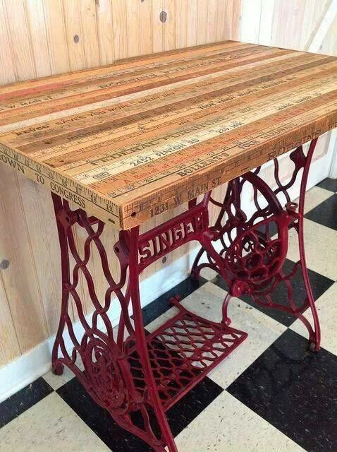 Whoa! An array of repurposed antique sewing machine bases --pretty neat!  fleaChic: flea market savvy