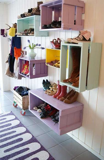 Great idea for a fun mud room.  I love that the crates are painted fun colours.