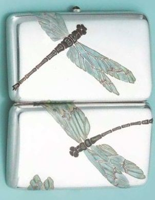 AN ART NOUVEAU SILVER AND ENAMEL CIGARETTE CASE BY LUCIEN GAILLARD. Rectangular silver case applied on each side with a dragonfly in green and brown enamel, with a pushpiece set with a red stone, circa 1900. Signed L. Gaillard. #ArtNouveau #Gaillard