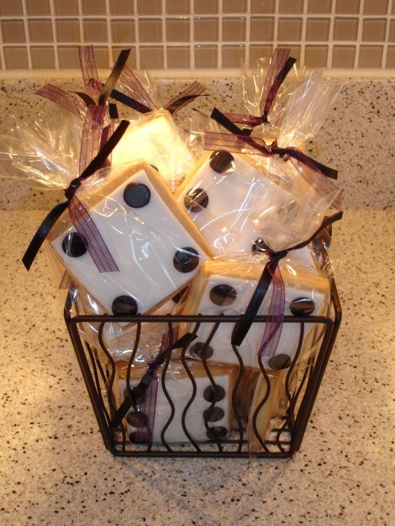Buy white cookie boxes and add black dots for dice. Put a cookie inside each box. Wrap box in cellophane and tie with ribbon. Give each bunco babe a treat on way out. (for Christmas)