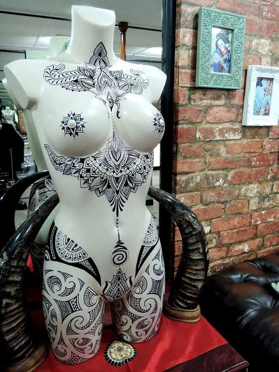 In the UK a tattoo shop called Adorned Tattoo shop has this mannequin torso on display. We have gently used torsos for sale at MannequinMadness.com for projects like this.