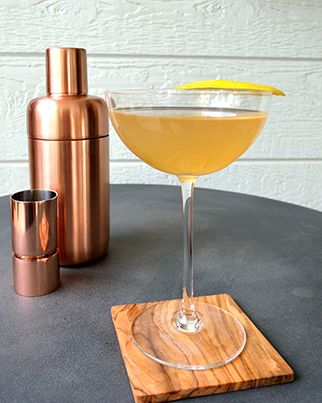 A riff on the original bees knees cocktail, the Jamaica Honey Bee replaces gin with rum. Get the recipe from the Solmonsons of 12 Bottle Bar.