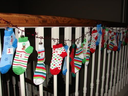 Christmas Coundown Socks; Dollar Spot (From Target) packs of holiday socks numbered 1-24; small treat or gift in each one counting down till Christmas! #kids #holidays #christmas