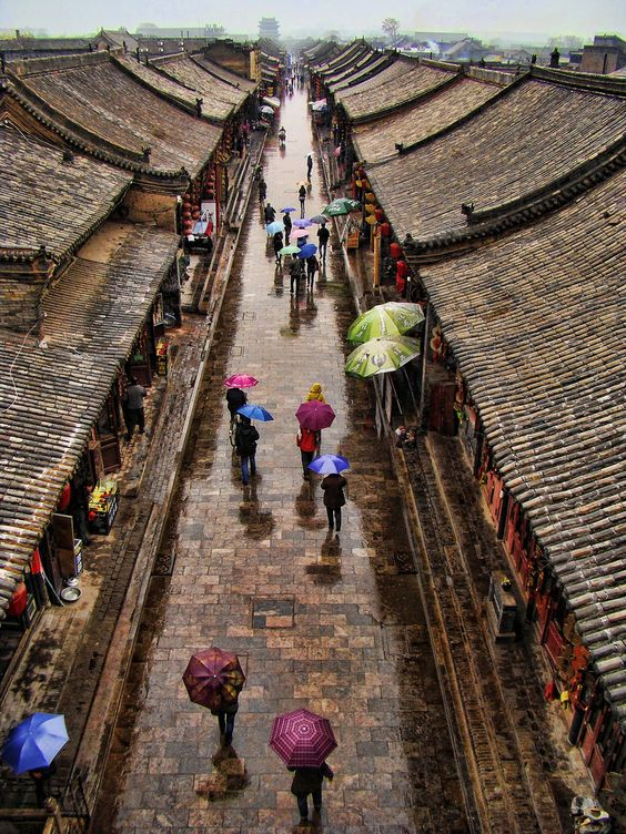 Pingyao, an ancient city in Northern China. ** Very traditional looking town. There aren't many of these left as they are being knocked down to build highrise buildings that no-one can afford to live in.