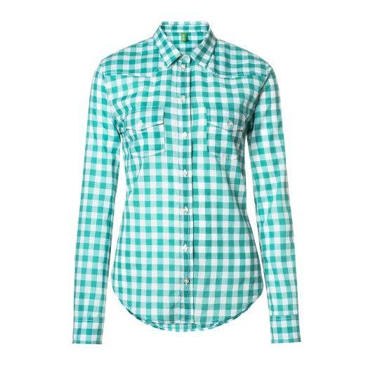 Camicia maniche lunghe, in cotone stampato, annodata sul fondo. Tasche a toppa altezza petto.