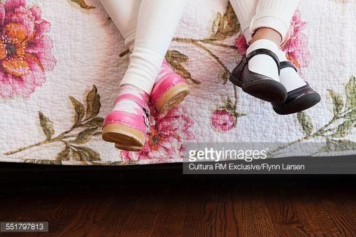 Stock-Foto : Two girls wearing shoes