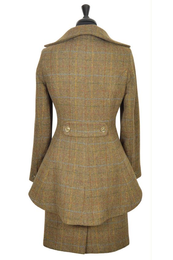 Lady Mary jacket Fiddich Tweed    The hips are softened and flattered.  The waist gently pinched and emphasised.  The back styled to appear to lengthen the female form.  The bust is advantaged by a Victorian era doublet-style structure.  Heritage-check Fiddich Tweed.  Exclusive Great Scot Gold embossed lining. Distinguished equestrian buttons in Old Bronze finish.  Made with love and pride, in the UK  Matching skirt available   Child version available