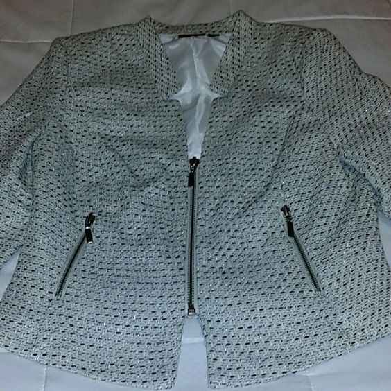 Gorgeous short jacket, size medium This is a stunning jacket with just a touch of sparkle and cool zipper accents. See photos. Jacket measures 20 inches down the back from the collar to the hem. Front is a little longer than the back. Beautiful cream, silver, and black colors make thus a very versatile top. Fully lined. Fabric is 96% acrylic, 4% other fibers. a.n.a Jackets & Coats