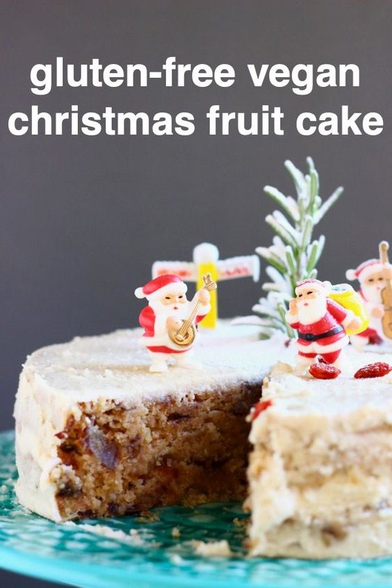 This Gluten-Free Vegan Christmas Fruit Cake is slightly boozy and perfectly spiced, seriously moist, and covered in the most indulgent cashew buttercream! The perfect dessert for Christmas and other holidays! Refined sugar free. #rhiansrecipes #christmas #fruitcake #vegan #glutenfree #dairyfree