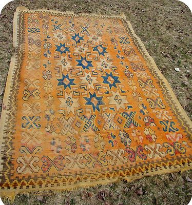 Old orange tribal rug