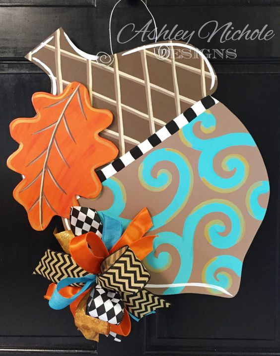 A pretty and classic look for fall! 24.5 H x 19.5 W Includes fun bow! Made of 1/4 plywood. Painted with outdoor quality paint. Painted black on the back for that polished look.