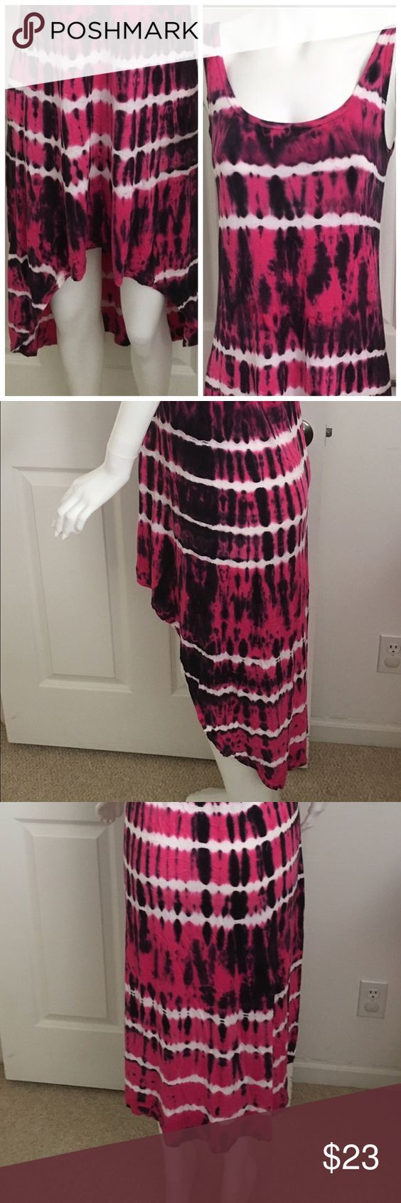 """Hard Tail sleeveless tie dye knit dress size S/M Hard Tail sleeveless tie dye knit dress size S/M. The tags are missing but it fits a small to medium. Here are the exact measurements. Armpit to armpit measures 16"""" lying flat. Waist measures 17"""" lying flat. Hips measure 18.5"""" lying flat. Asymmetrical hemline that is shorter in the front and longer in the back. Colors include pink white and black. Hard Tail Dresses Asymmetrical"""