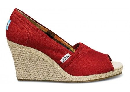 sweet mother of pearl, when did tom start making peep toe wedges?! now, for the first time in my life, i need a pair of toms.  red please.  :)