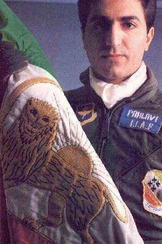 His Imperial Majesty, Reza Pahlavi, holding the flag of Iran with his pilot uniform. During the Iran-Iraq war, he submitted an application to the supreme leader to fight along side his country, where his offer was rejected. It is incredibly rare to see someone of his background and wealth to risk their life for their country.