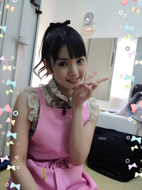 Morning Musume's Michishige Sayumi shows of her new pink apron