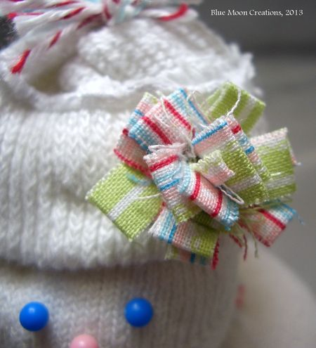 Fabric strip flower for sock snowgirl's hat.