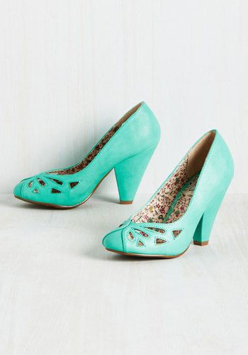 With each step taken in these teal pumps by Bettie Page, you revel in their retro style. Flaunting wrapping, topstitched toes, teardrop cutouts, and tapered heels, this faux-leather footwear leaves you leaping with chic delight!