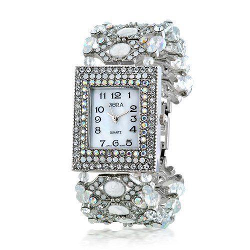 "Bling Jewelry CZ Opal Lite Womens Strand Evening Wear Watch [Watch] Geneva. $49.99. Cubic Zirconia. Face of watch measures 1.25"" L x 1"" W.. Opal Lite. Weighs 55.7 grams"