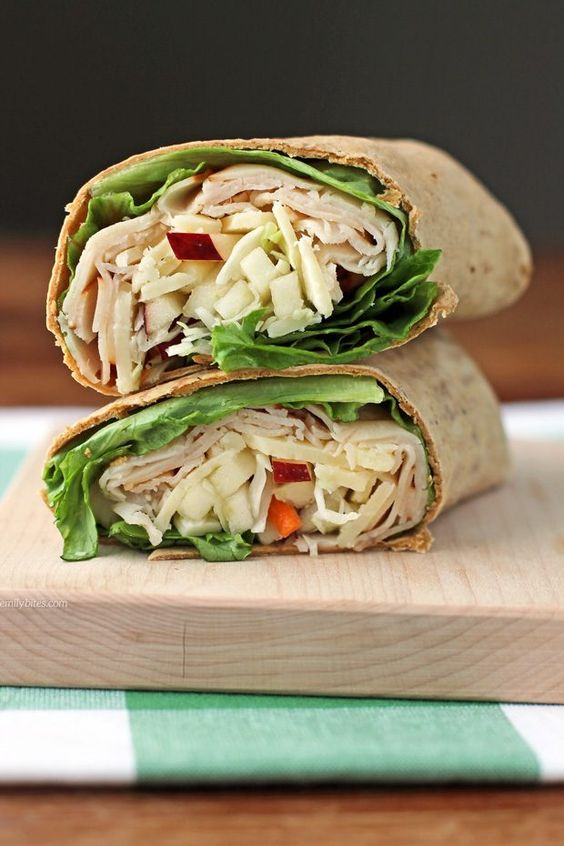These Apple Cheddar Turkey Wraps are a healthy, easy lunch idea at just 277 calories or 7 Weight Watchers SmartPoints. Packed with protein and fiber! www.emilybites.com