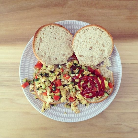 breakfast: herbed scrambled eggs w/ red bell peppers & zucchini sandwich.