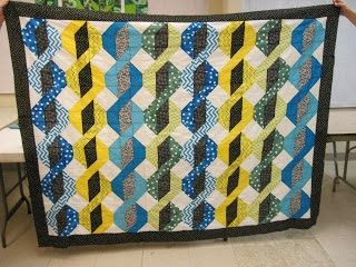 I design quilt patterns as well as teach quilting classes in Council Bluffs, IA.