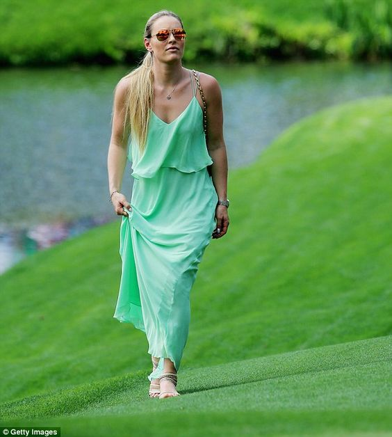 Lindsey Vonn dons gown to play caddie with Tiger Woods' kids #dailymail