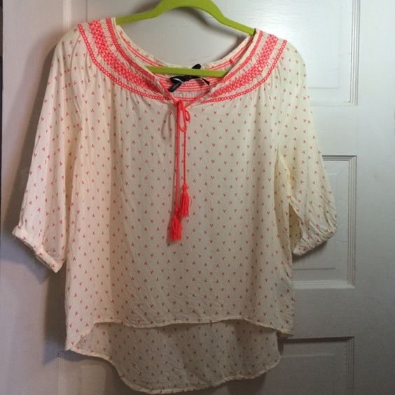 Neon and cream print top This cream top is comfortable and adds a pop of color to any outfit with its neon accents. Ali & Kris Tops