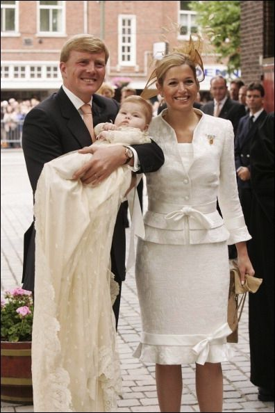 Máxima (in Valentino) and Willem-Alexander with their daughter Amalia in 2004