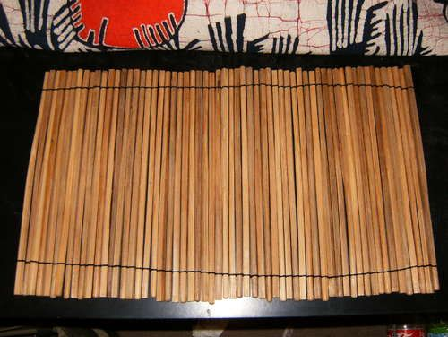 DIY placemats made from chopsticks -- could probably get wood stain and stain the chopsticks to your color of choice