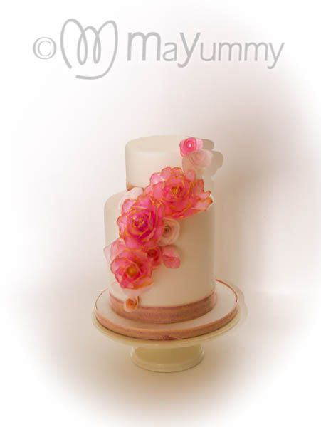 Wafer Paper Love.Simple yet elegant wedding cake with wafer paper roses (which are edible). The colous of cake and flowers can be designed to suit the colour scheme of your wedding.