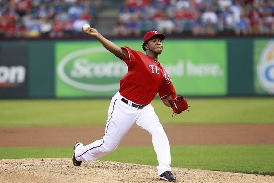 ARLINGTON, TX - APRIL 10: Neftali Feliz #30 of the Texas Rangers delivers a pitch against the Seattle Mariners at Rangers Ballpark in Arlington on April 10, 2012 in Arlington, Texas. (Photo by Rick Yeatts/Getty Images) game 5