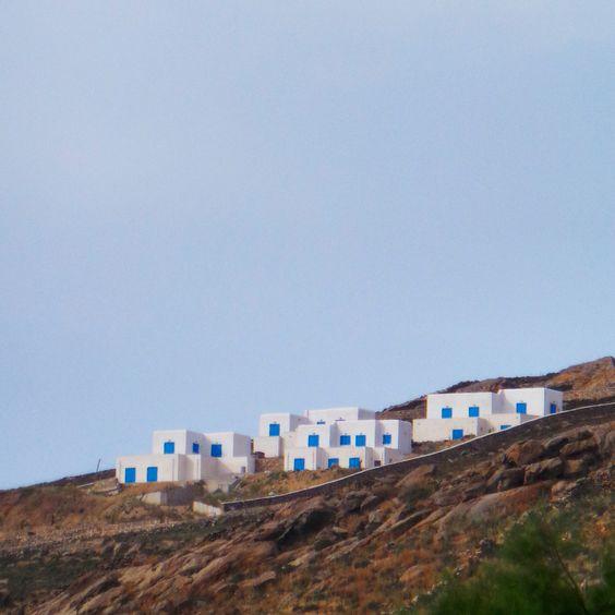 Bright white appartments in Mykonos, Greece.. #mykonos #greece #architecture #travel #mediterranian #coastline #colourful #contrast #sunshine #ilovegreece #bluesky #appartments