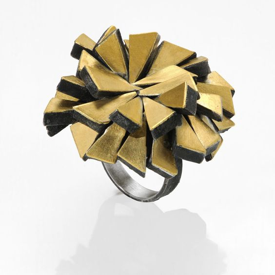 Gigi Mariani -   Firework , ring, 18kt yellow gold, Silver, niello. Photographer: Paolo Terzi