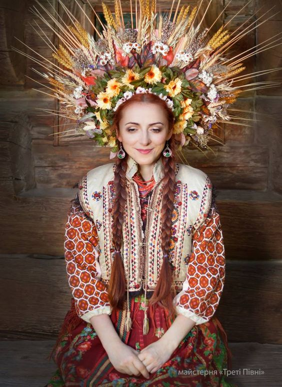 Beautiful Ukrainian woman with fabulous embroidered garment and headdress!