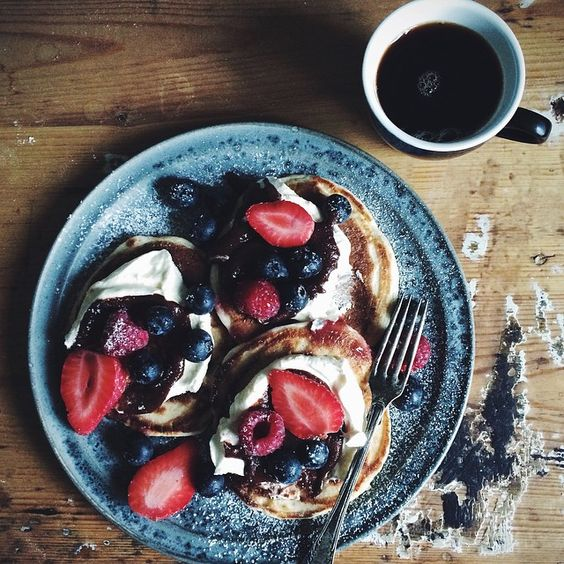 """""""Today's breakfast. Pancakes with whipped cream, homemade nutella and berries """""""