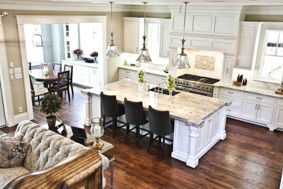 Craftsman style home. Love how the breakfast nook is attached, but separate and the kitchen opens into a great room. Would love I the formal dining is on the otherside with a butlers pass through. Look at the detailing on the island too!: