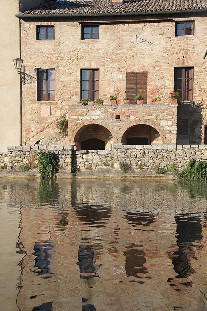 Bagno Vignoni is a small town in southern Tuscany, in the Val d'Orcia. It has natural hot springs running through town.
