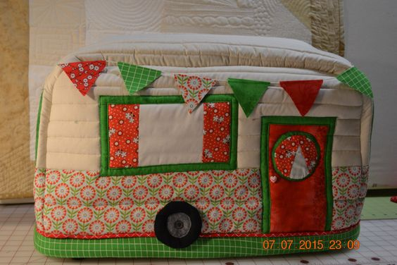 Vintage Caravan Sewing Machine Cover in reds and greens. Piping added in red.  Beautiful Sewing Machine Cover.  Updated from previous cover. by BaaStreet on Etsy https://www.etsy.com/listing/235658028/vintage-caravan-sewing-machine-cover-in