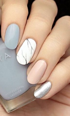 Spice up your typical pastel mani with a marbled accent nail. Keeping it in neutral shades prevents this look from going over the top.: