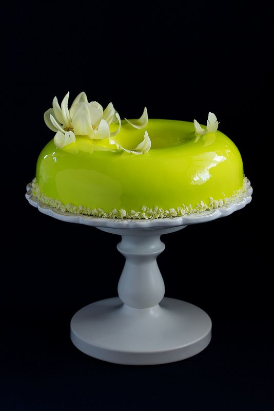 Pineapple mousse cake covered with a mirror coating.: