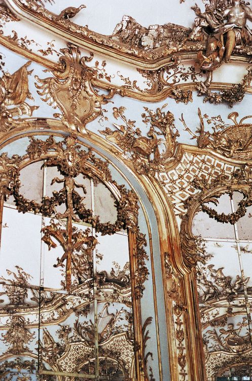 as rococo as a wall gets mirrors and stucco glop