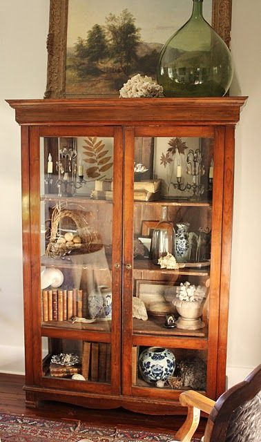 Love this piece of furniture. glass doored cabinet