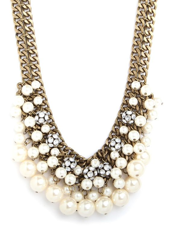 Why+not+have+your+pearls+with+a+side+of+edge?+That's+what+this+lovely+necklace—which+contrasts+chunky+brass+chains+with+lush+and+lavish+pearl+fringe—is+all+about.