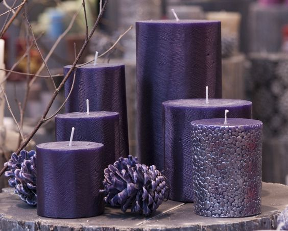 Group several purple candles or varying sizes for a great Christmas table centerpiece