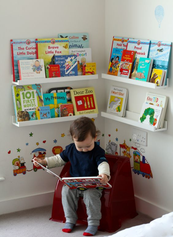"Montessori approach to providing a dedicated reading area for a toddler. As soon as we setup the book display, our 18 month old found his way, picked a book and sat down to ""read"" by himself.:"