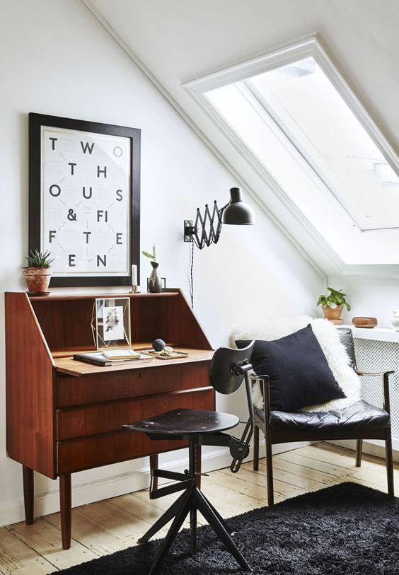 Una mansarda in stile newyorkese arredata con pezzi vintage danesi degli anni 50 e mobili di riciclo. http://www.mansarda.it/arredare/come-arredare-una-mansarda-in-stile-vintage/