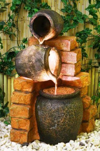 Fuente de agua con tinajas de aceite y luces ps for Tinajas de barro para jardin