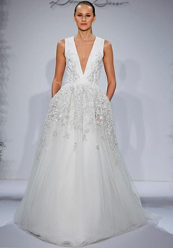 Ivory plunging v-neck gown with hand beaded netting over silk organza with tulle a-line skirt | Dennis Basso for Kleinfeld | https://www.theknot.com/fashion/first-lady-dennis-basso-for-kleinfeld-wedding-dress