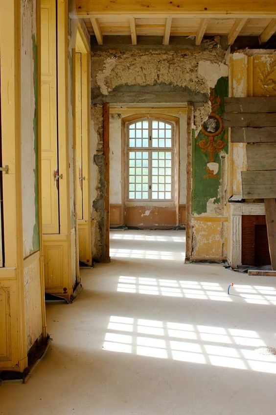 Chateau Gudanes interior undergoing renovation with peeling wallpaper, layers of paint, and magnificent decay. South of France Fixer Upper Château Gudanes. #southoffrance #frenchchateau #provence #frenchcountry #renovation