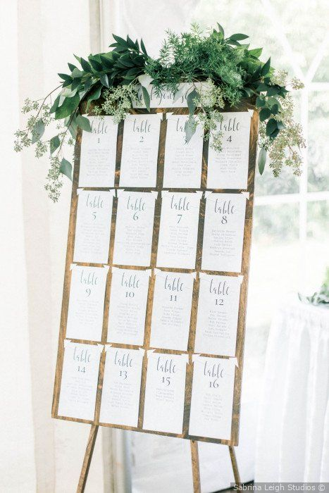 Wedding seating chart - Wooden sign + greenery decor + table cards {Sabrina Leigh Studios}